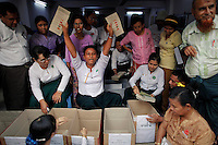 An election official shows ballots with votes for Myanmar's pro-democracy leader Aung San Suu Kyi's party National League for Democracy (NLD) as votes are counted in Yangon April 1, 2012. Myanmar voted on Sunday in its third election in half a century. REUTERS/Damir Sagolj (MYANMAR - Tags: POLITICS ELECTIONS)