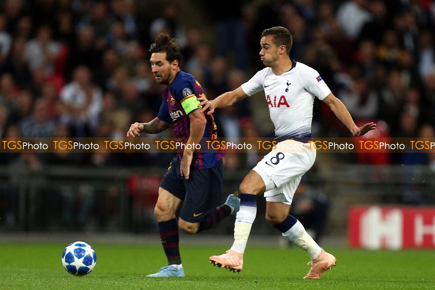 Lionel Messi of FC Barcelona and Harry Winks of Tottenham Hotspur during Tottenham Hotspur vs FC Barcelona, UEFA Champions League Football at Wembley Stadium on 3rd October 2018