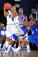 25 February 2010:  FIU's Phil Gary, Jr. (4) recovers a loose ball in the first half as the Middle Tennessee Blue Raiders defeated the FIU Golden Panthers, 74-71, at the U.S. Century Bank Arena in Miami, Florida.