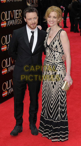 James McAvoy & Anne-Marie Duff.The Laurence Olivier Awards held at the Royal Opera House - Arrivals, London, England..April 28th, 013.full length black suit dress grey gray pattern married husband wife beard facial hair .CAP/CAN.©Can Nguyen/Capital Pictures.