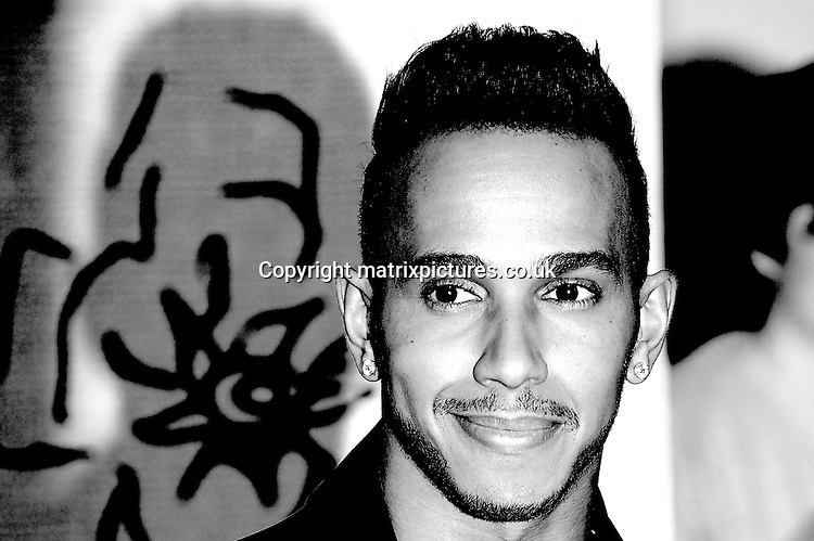 NON EXCLUSIVE PICTURE: PAUL TREADWAY / MATRIXPICTURES.CO.UK<br /> PLEASE CREDIT ALL USES<br /> <br /> WORLD RIGHTS<br /> <br /> British Formula One racing driver Lewis Hamilton attending the BRIT Awards 2015 at the O2 Arena, in London.<br /> <br /> FEBRUARY 25th 2015<br /> <br /> REF: PTY 15627