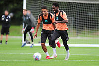 Kyle Naughton vies for possession with Nathan Dyer of Swansea City during the Swansea City Training Session at The Fairwood Training Ground, Wales, UK. Tuesday 11th September 2018