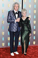 Brian May and Anita Dobson<br /> arriving for the BAFTA Film Awards 2019 at the Royal Albert Hall, London<br /> <br /> ©Ash Knotek  D3478  10/02/2019
