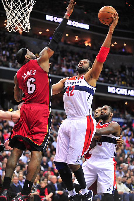 Nene of the Wizards goes up strong to the basket against Heat's Lebron James. Washington Wizards defeated the Miami Heat 105-101 at the Verizon Center in Washington, D.C. on Tuesday, December 4, 2012.   Alan P. Santos/DC Sports Box