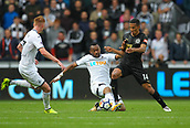 10th September 2017, Liberty Stadium, Swansea, Wales; EPL Premier League football, Swansea versus Newcastle United; Jordan Ayew of Swansea City slides in to tackle Isaac Hayden of Newcastle United