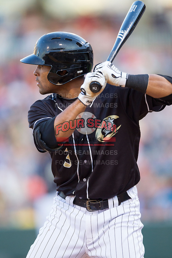 Micah Johnson (3) of the Charlotte Knights at bat against the Indianapolis Indians at BB&T Ballpark on May 23, 2014 in Charlotte, North Carolina.  The Indians defeated the Knights 15-6.  (Brian Westerholt/Four Seam Images)