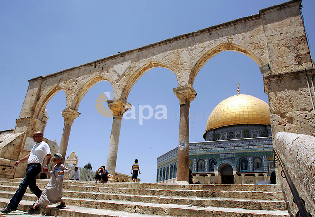 Palestinian Muslims walk in front of the Dome of Rock after Friday prayers in the Al Aqsa Mosque compound, also known to Jews as the Temple Mount, in Jerusalem's old city on July 9, 2010. Israel's recent announcement of the four Hamas members of the Palestinian Legislative Council were stripped of their residency rights and given a deadline to leave the city. Photo by Mahfouz Abu Turk