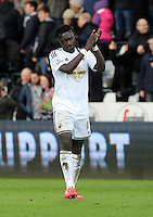 SWANSEA, WALES - FEBRUARY 21: Bafetimbi Gomis of Swansea thanks supporters at the end of the Barclays Premier League match between Swansea City and Manchester United at Liberty Stadium on February 21, 2015 in Swansea, Wales.