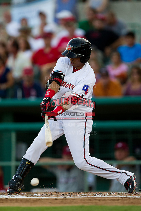 Leonys Martin (20) of the Frisco RoughRiders hits a ground ball during a game against the North All-Stars 2011 in the Texas League All-Star game at Nelson Wolff Stadium on June 29, 2011 in San Antonio, Texas. (David Welker / Four Seam Images)..