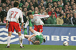 Dublin Ireland, Ireland's No 11 Damien Duff tumbles off  as China's No 3 Sun Xiang clears the ball during the friendly international soccer match in Lansdowne Road, Stadium, Dublin, Irelande, 29/3/05.Photo AFP/NEWSFILE/FRAN CAFFREY..(Photo credit should read  AFP Photo FRAN CAFFREY/NEWSFILE)...This Picture has been sent you under the condtions enclosed by:.Newsfile Ltd..the Studio,.Millmount Abbey,.Drogheda,.Co Meath..Ireland..Tel: +353(0)41-9871240.Fax: +353(0)41-9871260.GSM: +353(0)86-2500958.email: pictures@newsfile.ie.www.newsfile.ie.FTP: 193.120.102.198..This picture is from Fran Caffrey@newsfile.ie