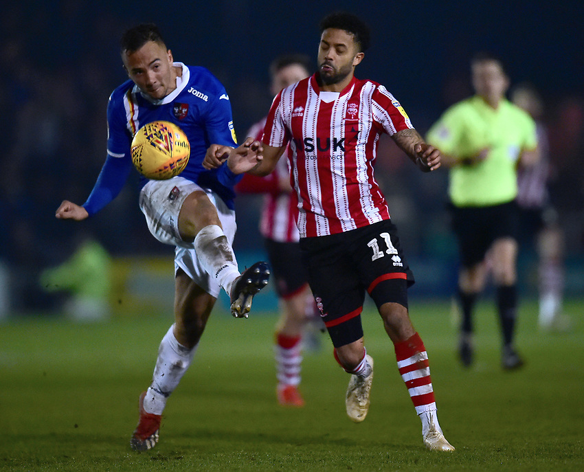 Lincoln City's Bruno Andrade vies for possession with Exeter City's Kane Wilson<br /> <br /> Photographer Andrew Vaughan/CameraSport<br /> <br /> The EFL Sky Bet League Two - Lincoln City v Exeter City - Tuesday 26th February 2019 - Sincil Bank - Lincoln<br /> <br /> World Copyright © 2019 CameraSport. All rights reserved. 43 Linden Ave. Countesthorpe. Leicester. England. LE8 5PG - Tel: +44 (0) 116 277 4147 - admin@camerasport.com - www.camerasport.com