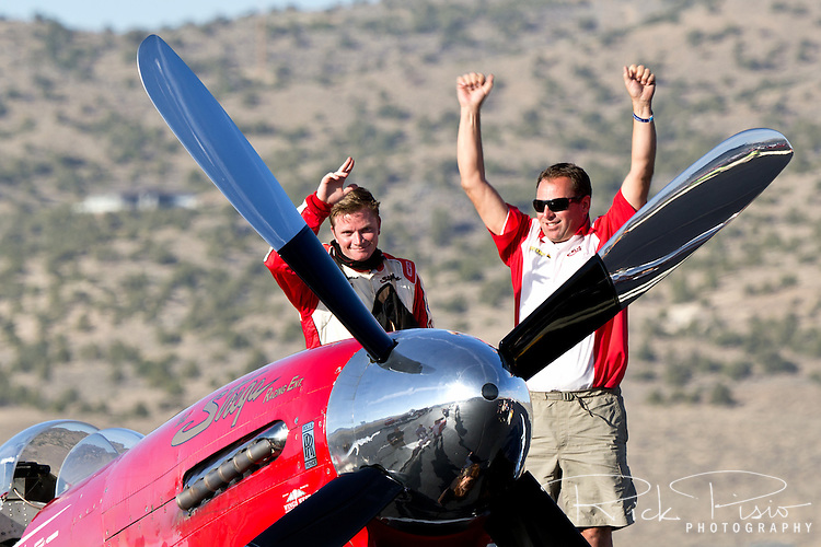 Pilot Steve Hinton and Crew Chief David Hughes acknowledge Strega's victory in the 2012 Unlimited Gold Championship race.
