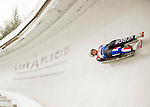 """5 December 2015: Karoline Melaas, competing for Norway, slides through Curve 10 """"Shady"""" on her first run of the Viessmann World Cup Women's Luge at the Olympic Sports Track in Lake Placid, New York, USA. Mandatory Credit: Ed Wolfstein Photo *** RAW (NEF) Image File Available ***"""