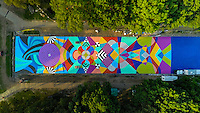 The City of Philadelphia Mural Arts Program and the Fairmount Park Conservancy commissioned artists Jessie Unterhalter and Katey Truhn to design Summer Kaleidoscope, a mural in Eakins Oval. The artists led a team of painters, completing the mural on July 13, 2014.