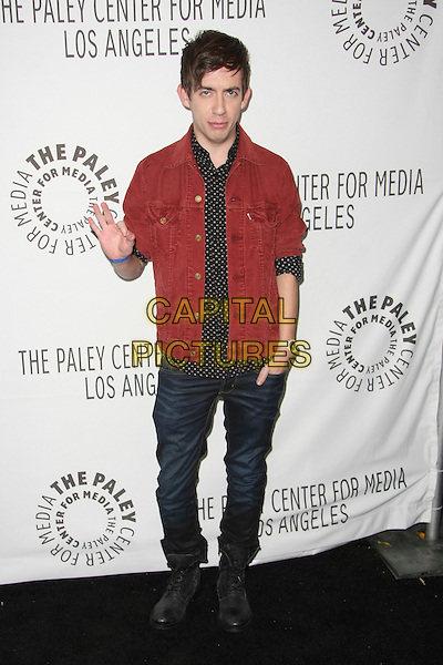 """KEVIN McHALE.The PaleyFest 2011 Panel for """"Glee"""" held at The Saban Theater in Beverly Hills, California, USA..March 16th, 2011.full length jeans red denim jacket black white print polka shirt boots work corduroy hand in pocket wrist watch jacket ok okay sign symbol.CAP/ADM/TB.©Tommaso Boddi/AdMedia/Capital Pictures."""