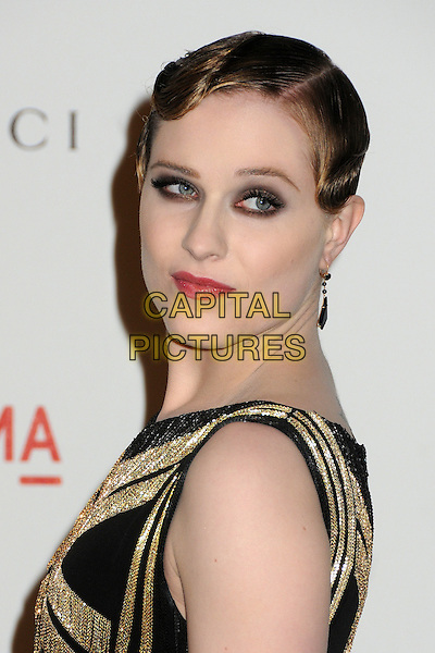 Evan Rachel Wood.The Inaugural Art and Film Gala held at LACMA in Los Angeles, California, USA..November 5th, 2011.headshot portrait black dress sleeveless gold tassels fringed dangling earrings wavy hair waves eyeshadow make-up beauty side .CAP/ADM/BP.©Byron Purvis/AdMedia/Capital Pictures.