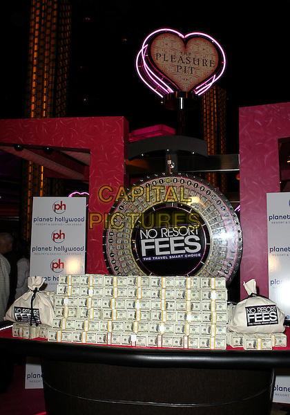 ATMOSPHERE .Holly Madison Unveils 12.7 Million Dollars That Las Vegas Visitors Will Save By Not Paying Resort Fees At Planet Hollywood Resort Casino, Las Vegas, Nevada, USA, .29th July 2010..money cash dollars.CAP/ADM/MJT.© MJT/AdMedia/Capital Pictures.