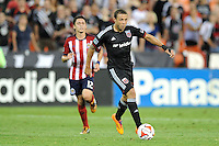 Washington, D.C.- July 20, 2014. Nick DeLeon (14) of D.C. United.  D.C. United defeated Chivas USA 3-1 during a Major League Soccer Match for the 2014 season at RFK Stadium.