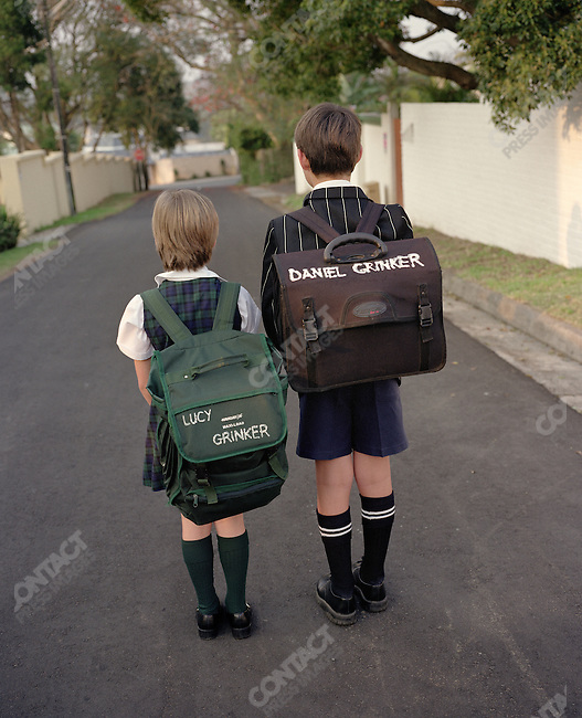 Lucy and Daniel Grinker on their way to school, East London, South Africa, 2005