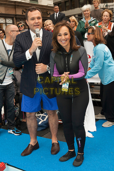 Greg Kelly, Rosanna Scotto<br /> attends the 'Swim for Relief' Benefiting Hurricane Sandy Recovery at Herald Square, New York City, NY., USA.<br /> October 9th, 2013 <br /> full length black wetsuit blue shorts jacket<br /> CAP/MPI/COR<br /> &copy;Corredor99/ MediaPunch/Capital Pictures