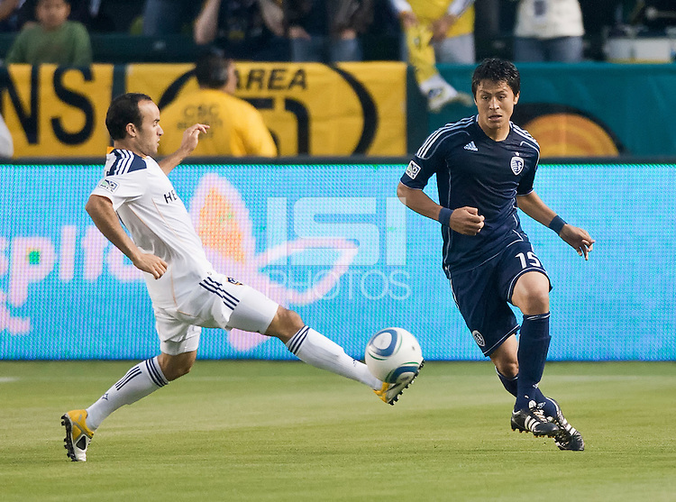 CARSON, CA – May 14, 2011: Sporting KC defender Roger Espinoza (15) attempts to get a pass by LA Galaxy midfielder Landon Donovan (10) during the match between LA Galaxy and Sporting Kansas City at the Home Depot Center in Carson, California. Final score LA Galaxy 4, Sporting Kansas City 1.