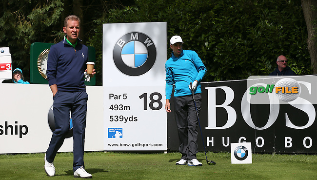 Ross Fisher (ENG) drives the 18th and watched by Jeremy Kyle during the Pro-Am ahead of the 2015 BMW PGA Championship over the West Course at Wentworth, Virginia Water, London. Picture David Lloyd, www.golffile.ie: 20/05/2015