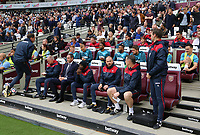 The Swansea bench, Nigel Gibbs, Paul Clement, Claude Makelee, Karl Halabi and Tony Roberts during the Premier League match between West Ham United v Swansea City at the London Stadium, London, England, UK. Saturday 30 September 2017