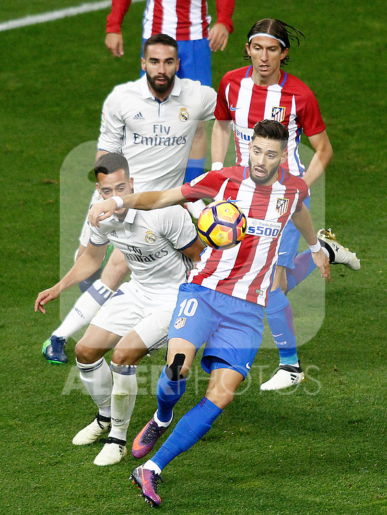 Atletico de Madrid's Filipe Luis (t-r) and Yannick Ferreira Carrasco (d-r) and Real Madrid's Daniel Carvajal (t-l) and Lucas Vazquez during La Liga match. November 19,2016. (ALTERPHOTOS/Acero)