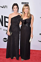 HOLLYWOOD, CA - JUNE 07: Courteney Cox, Jennifer Aniston arrive at the American Film Institute's 46th Life Achievement Award Gala Tribute To George Clooney at the Dolby Theatre on June 7, 2018 in Hollywood, California.<br /> CAP/ROT/TM<br /> &copy;TM/ROT/Capital Pictures