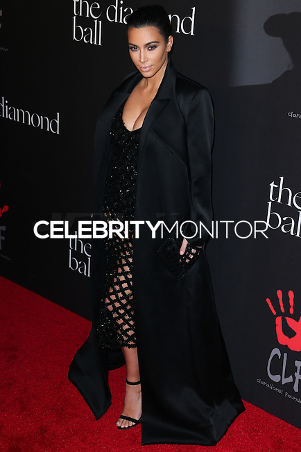 BEVERLY HILLS, CA, USA - DECEMBER 11: Kim Kardashian arrives at Rihanna's 1st Annual Diamond Ball held at The Vineyard Beverly Hills on December 11, 2014 in Beverly Hills, California, United States. (Photo by Xavier Collin/Celebrity Monitor)