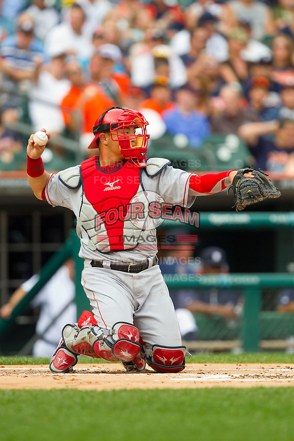 Los Angeles Angels catcher Hank Conger (16) throws the ball back to his pitcher during the Major League Baseball game against the Detroit Tigers at Comerica Park on June 25, 2013 in Detroit, Michigan.  The Angels defeated the Tigers 14-8.  (Brian Westerholt/Four Seam Images)