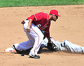New York Mets shortstop Jose Reyes (7) is tagged out by Washington Nationals shortstop Ian Desmond (6) trying to steal in the fifth inning at Nationals Park in Washington, D.C. on Sunday, July 31, 2011.  .Credit: Ron Sachs / CNP.(RESTRICTION: NO New York or New Jersey Newspapers or newspapers within a 75 mile radius of New York City)