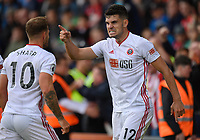 Sheffield United's John Egan (right) celebrates after Sheffield United's Billy Sharp (left) scores his side's first goal  <br /> <br /> Photographer David Horton/CameraSport<br /> <br /> The Premier League - Bournemouth v Sheffield United - Saturday 10th August 2019 - Vitality Stadium - Bournemouth<br /> <br /> World Copyright © 2019 CameraSport. All rights reserved. 43 Linden Ave. Countesthorpe. Leicester. England. LE8 5PG - Tel: +44 (0) 116 277 4147 - admin@camerasport.com - www.camerasport.com