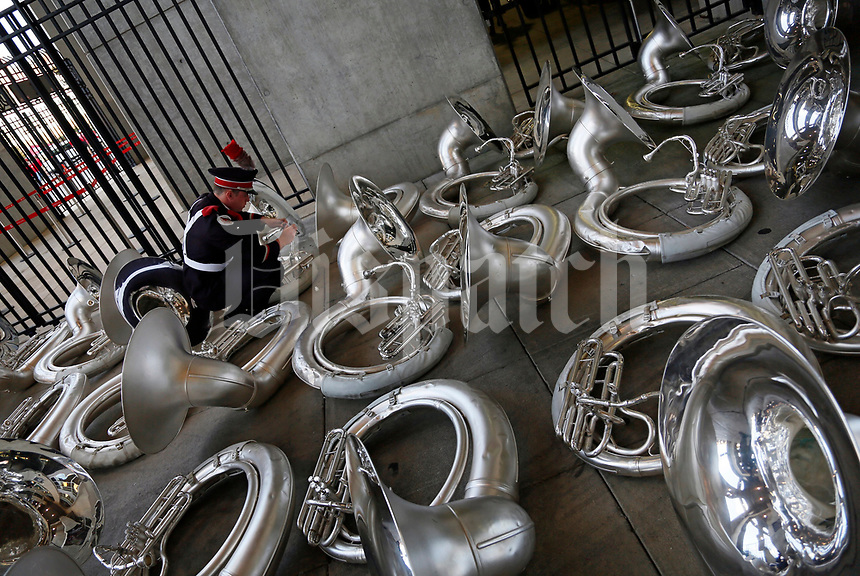 Ohio State University Marching Band member Dan McCullough of Massillon oils the valves of his sousaphone prior to the NCAA football game between the Ohio State Buckeyes and the Oklahoma Sooners in Columbus on Sept. 9, 2017. [Adam Cairns/Dispatch]