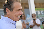Massapequa, New York, USA. August 5, 2018. Governor ANDREW CUOMO, running for re-election, is a special guest at opening of joint campaign office for Grechen Shirley and NY Sen. J. Brooks, aiming for a Democratic Blue Wave in November midterm elections.
