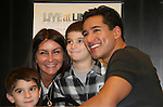 Fans pose with Bold and The Beautiful's Mario Lopez with a new book Mud Tacos or Tacos de Lodo on October 16, 2009 at Lincoln Square Barnes & Noble, New York City, New York. (Photos by Sue Coflin/Max Photos)