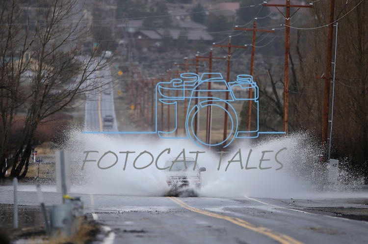Cars drive through standing water as another winter storm rolls through Northern Nevada, in Gardnerville, Nev. on Friday, Feb. 10, 2017.  <br /> Photo by Cathleen Allison/Nevada Photo Source