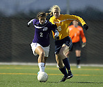SIOUX FALLS, SD - NOVEMBER 1:  Elisa Glab #2 from the University of Sioux Falls battles for the ball with Annie Thoresen #26 from Augustana in the first half of their game Friday night at the USF Sports Complex. (Photo by Dave Eggen/Inertia)
