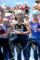 09 MAY 2004 - FUNCHAL, MADEIRA - Maki Shimomura (JPN) races to T1 during the Elite Womens World Triathlon Championships. (PHOTO (C) NIGEL FARROW)