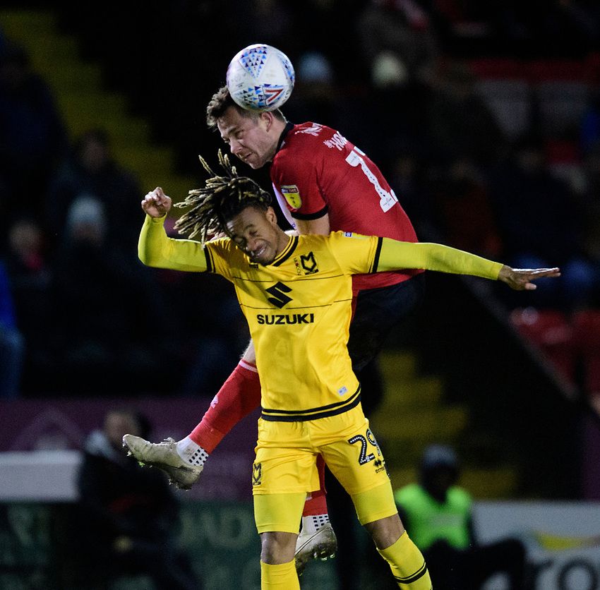 Lincoln City's Tom Hopper vies for possession with Milton Keynes Dons' David Kasumu<br /> <br /> Photographer Chris Vaughan/CameraSport<br /> <br /> The EFL Sky Bet League One - Lincoln City v Milton Keynes Dons - Tuesday 11th February 2020 - LNER Stadium - Lincoln<br /> <br /> World Copyright © 2020 CameraSport. All rights reserved. 43 Linden Ave. Countesthorpe. Leicester. England. LE8 5PG - Tel: +44 (0) 116 277 4147 - admin@camerasport.com - www.camerasport.com