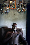 KITWE, ZAMBIA MARCH 25: Mr. Albert Mwanaumo, a mineworker, sits in pain in his small house on March 25, 2007 in Kitwe, Zambia. He worked at Chimbishi, a Copper mine run by a Chinese company, and after striking and protesting, he was shot by a Chinese man. He still has bullets in his body and a terrible pain. The Chinese man was never charged and he flew back to China. Albert is now out of work and is struggling to support his family. He needs urgently to go to hospital to take out the bullets. The Chinese mine has not paid for his medical care. The mining management has been accused of floating safety rules and paying less salaries and benefits than the earlier owner..(Photo by Per-Anders Pettersson).