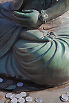 Kyoto City, Japan<br /> Adashino Nenbutsu-ji Temple, detail of Buddha statue with coin offerings
