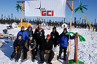 """Thursday  March 11 , 2010  The """" Cripple Crew """" volunteers pose for a photo outside of there """" town """" .  Cripple is the most remote checkpoint on the Northern route where everything must be flown in to support life ."""