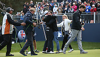 Matthew Fitzpatrick (ENG) joined by brother and mother on the 18th to celebrate winning the Final Round of the British Masters 2015 supported by SkySports played on the Marquess Course at Woburn Golf Club, Little Brickhill, Milton Keynes, England.  11/10/2015. Picture: Golffile | David Lloyd<br /> <br /> All photos usage must carry mandatory copyright credit (© Golffile | David Lloyd)