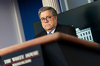 United States Attorney General William P. Barr participates in a news briefing by members of the Coronavirus Task Force at the White House in Washington, DC on Monday, March 23, 2020. <br /> Credit: Chris Kleponis / Pool via CNP/AdMedia