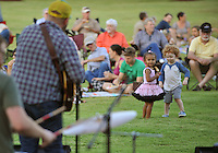 NWA Democrat-Gazette/MICHAEL WOODS • @NWAMICHAELW<br /> Kai-Lani Anderson, 2, from Fayetteville (left) and Elijah Danner, 3, from Fayetteville, dance to the music of Smokey & The Mirror Tuesday September 29. 2015 at the Botanical Garden of the Ozarks in Fayetteville. It was the final free concert of the 2015 Summer Concert Series at the garden.