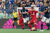 FOXBOROUGH, MA - AUGUST 31: Patrick Mullins #13 of Toronto FC passes the ball during a game between Toronto FC and New England Revolution at Gillette Stadium on August 31, 2019 in Foxborough, Massachusetts.