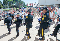 The special American flag is brought back at the end of the ceremonies by an honor guard comprised of Huntington Beach police and firefighters.<br /> <br /> ///ADDITIONAL INFORMATION: hb.0915.memorial &ndash; 9/11/16 &ndash; MICHAEL KITADA, ORANGE COUNTY REGISTER - _DSC8651.jpg - <br /> Summary: The Huntington Beach Police Officers' Foundation's 9-11 Memorial Committee unveils a $200,000 monument including steel from the toppled World Trade Center, at City Hall. The event will include music, a flyover, New York police and others with connections to the 9-11 rescue and victims of the tragedy.