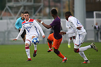 Lilian Perrier of Olympique Lyonnais gets ready to tackle Manchester City's Rabbi Matondo during Lyon Under-19 vs Manchester City Under-19, UEFA Youth League Football at Groupama OL Academy on 27th November 2018