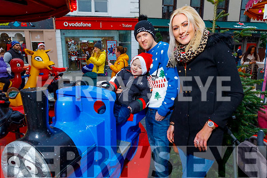 Little Rian Hurley on Thomas the Tank engine with dad Francis Hurley and mom Sharon Teahan enjoying the festive fun at the Snow Day in the square in Tralee on Saturday.